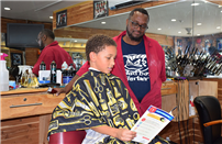 Books Unite Barbers and South Country Students photo
