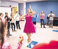 Dance teacher Stephanie Vertichio leads a group of fifth-grade students