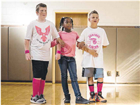 Fifth-graders Austin Richutti, Gianna Bowe and Tyler Miller listen to instructions