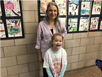 Pictured are Artist Lorena Salcedo-Watson & Kindergarten Student Kaiya Griffin