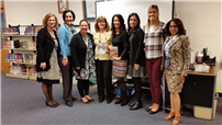 Author Regina Calcaterra pictured with Brookhaven Elementary School staff.  thumbnail77692